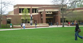 Students walking to class in front of Gould Library